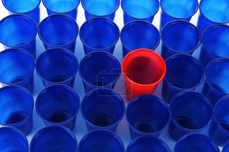 Individuality concept. Bright plastic disposable tableware, close-up