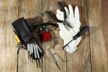 Photo for Tools of picking locks on wooden table - Royalty Free Image
