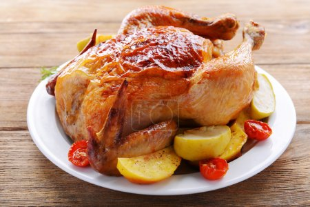Photo for Delicious baked chicken on plate on table close-up - Royalty Free Image