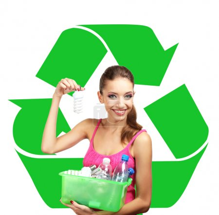 Recycle concept, beautiful young woman holding container with light bulbs and plastic bottles isolated on white