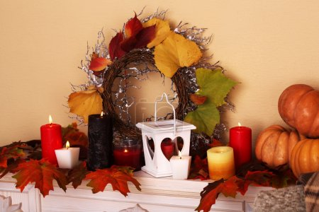 Festive autumn decor on fireplace