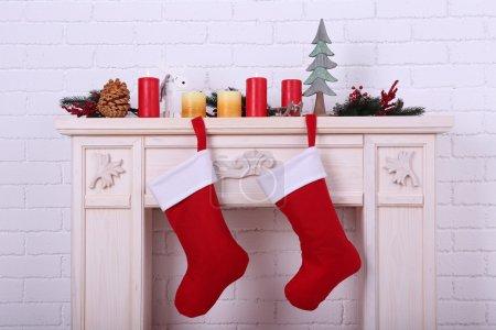 Christmas socks on fireplace