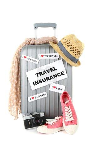 Travel suitcase and tourist stuff