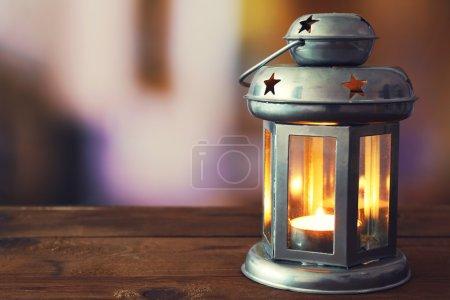 Lantern on wooden surface
