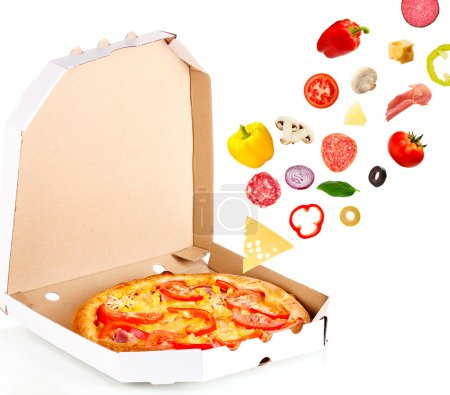Tasty pizza in box and falling ingredients isolated on white