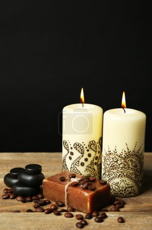 Photo for Beautiful spa composition with decorative Indian candles, on wooden table - Royalty Free Image