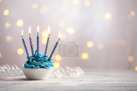Photo for Delicious birthday cupcake on table on light background - Royalty Free Image