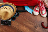 "Постер, картина, фотообои ""Suitcase and tourist stuff with inscription travel insurance on wooden background"""