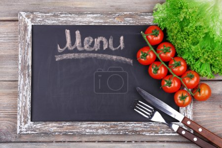 Photo for Blackboard menu on rustic wooden planks background - Royalty Free Image