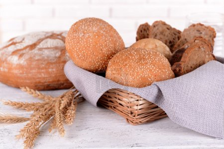 Tasty bread on table on light background