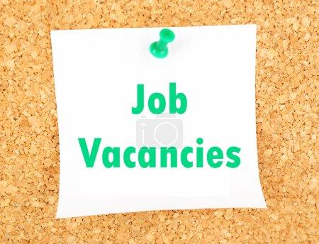 Job Vacancies text pinned up to board