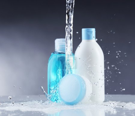 Cosmetic products in water splashes