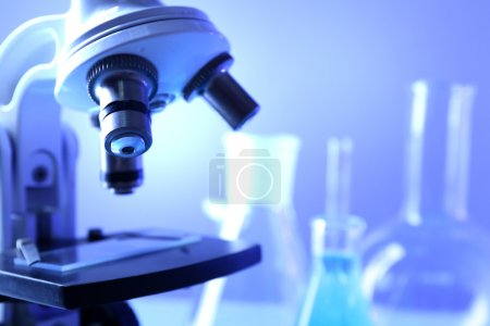 Microscope close-up on color background