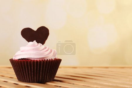 Photo for Delicious Valentine Day cupcake on light background - Royalty Free Image