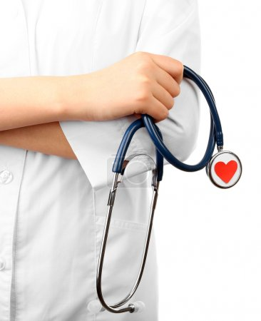 Stethoscope with heart in doctor hands