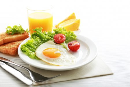 Photo for Bacon and eggs on color wooden table background - Royalty Free Image