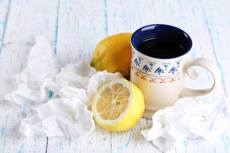 Hot tea for colds and handkerchiefs on table close-up