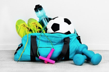 Photo for Sports bag with sports equipment in room - Royalty Free Image