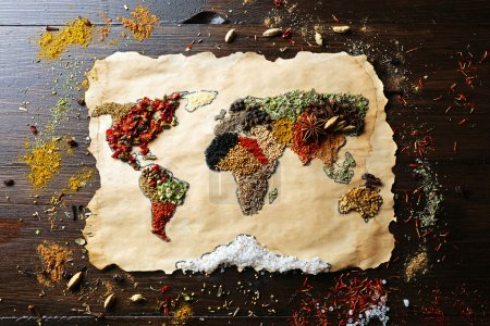 Photo for Map of world made from different kinds of spices on wooden background - Royalty Free Image