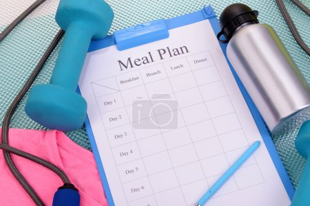 Photo for Meal plan and sports equipment top view close-up - Royalty Free Image