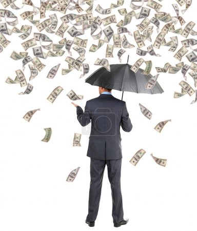 Photo for Businessman standing in the rain of money - Royalty Free Image