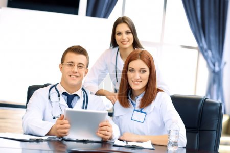 Medical workers working in conference room...