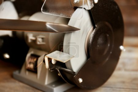 Photo for Knife sharpener on wooden table, closeup - Royalty Free Image