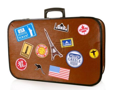 Photo pour Valise de voyage avec autocollants isolés sur fond blanc - image libre de droit