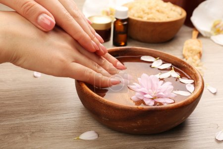 Female hands with bowl of spa water