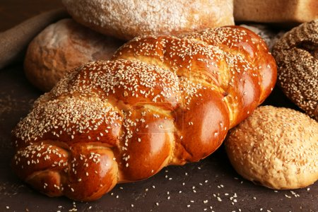 Different bread on wooden background