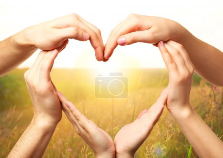 Photo for Heart shaped by hands on nature background - Royalty Free Image