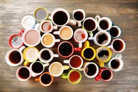Photo for Many cups of coffee on wooden table, top view - Royalty Free Image
