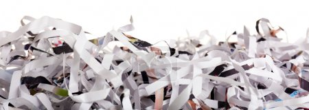 Strips of destroyed paper from shredder isolated on white