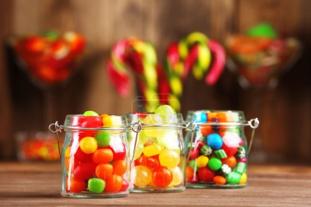 Photo for Colorful candies in jars on table in shop - Royalty Free Image