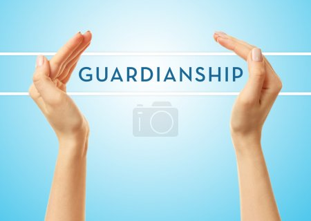 Female hands with word guardianship on blue background