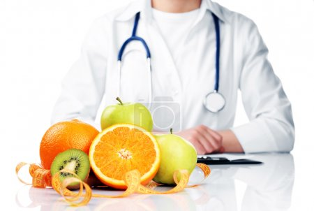 Nutritionist doctor with fruits