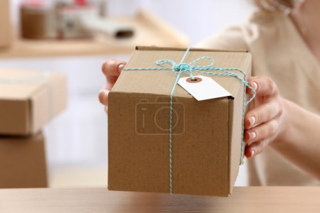 Photo for Woman gives parcel in post office - Royalty Free Image