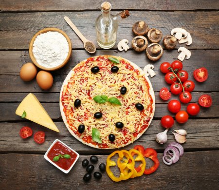 Photo for Food ingredients for pizza on table close up - Royalty Free Image