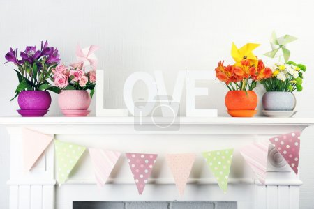 Beautiful flowers in ornamental flowerpot