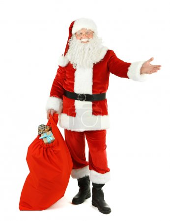 Photo for Santa Claus with bag, filled gift boxes isolated on white background - Royalty Free Image