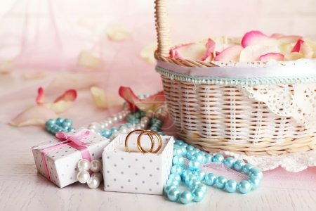 Wedding basket with roses petals