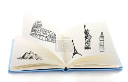 Photo pour Ouvrir le livre avec les dessins isolés sur blanc - image libre de droit