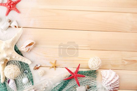 Beautiful sea composition with shells on wooden background