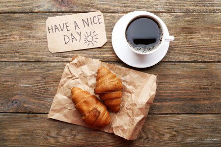 Photo for Cup of coffee with fresh croissant and Have A Nice Day massage on wooden table, top view - Royalty Free Image