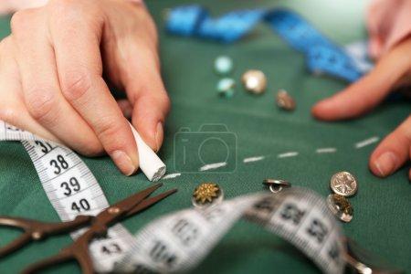 Hands of seamstress at work