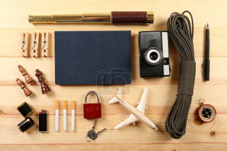 Photo for Travel gear on wooden table, top view - Royalty Free Image