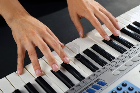 Photo for Woman playing synthesizer close up - Royalty Free Image