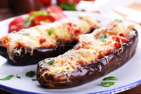 Dish of eggplant with cherry tomatoes