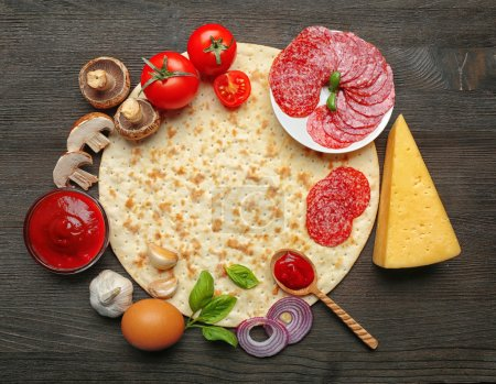 Photo for Ingredients for cooking pizza on wooden table, top view - Royalty Free Image