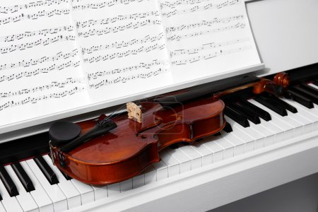 Photo for Piano with violin and music notes close up - Royalty Free Image